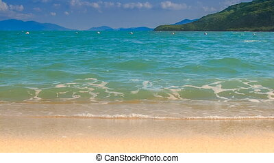 wave surf of azure sea with sand beach on foreground - foamy...
