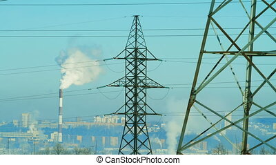 High voltage tower in time lapse motion. Smoke from pipes