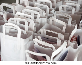White paperbags in rows - White paper bags in straight rows