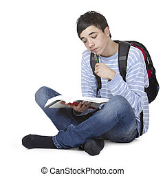 Young handsome male student learining with study book -...