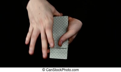 Trick of magician with cards - the same card, on black,...