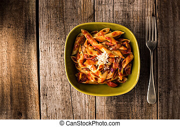 Penne Pasta with Chorizo Creamy Tomato Sauce on Rustic Table...