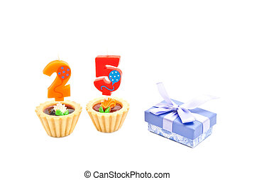 cakes with twenty five years birthday candles and gift on...
