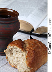 Communion - Bread, chalice with red wine and Holy Bible....