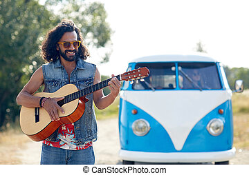 hippie man playing guitar over minivan car outdoor - nature,...