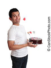 Cheeky man with a love heart cake - Cheeky flirtatious man...