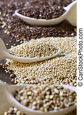 seeds of buckwheat, quinoa and brown flax - closeup of some...