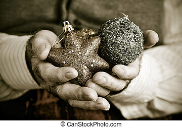 old man with christmas ornaments, in sepia toning - closeup...