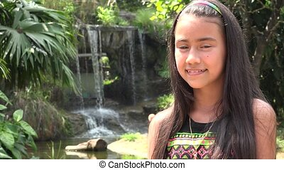 Teen Girl Posing at Waterfall