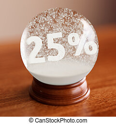 Snow globe with 25 percent discount title inside on wooden...