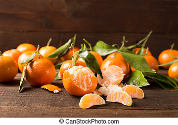 clementines - tangerine clementine on the wooden table
