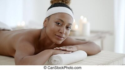 Woman On Massage Table - Young african-american woman on...