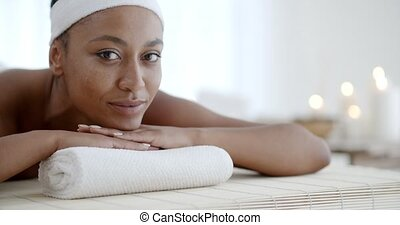 Woman Relaxing On A Pillow - Young woman in a spa relaxing...