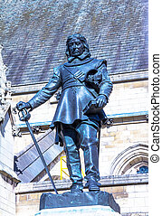 Oliver Cromwell - 1899 statue by Hamo Thornycroft in front...