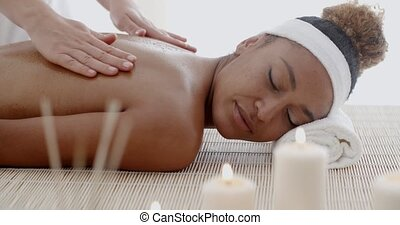 Woman Receiving Back Massage - Closeup of happy african...