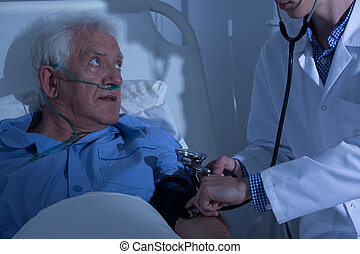 Senior patient examined by doctor - Recovering senior...