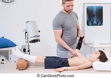 Pediatric physiotherapist treating little patient - Image of...