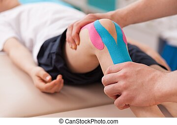 Exercise for knee - Physiotherapist doing with child...