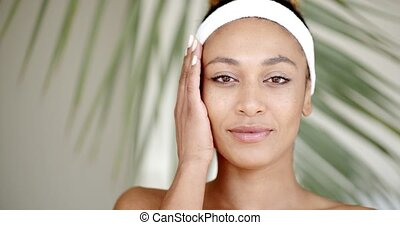 Woman With Makeup Touching Her Face