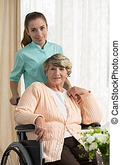 Care assistant pushing the wheelchair