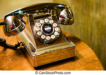 Golden desk phone - A gleaming gold telephone waiting for...