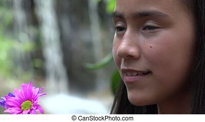 Teen Girl with Flowers at Waterfall