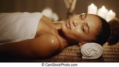 Smiling Woman In A Spa - Woman in spa salon lying on the...