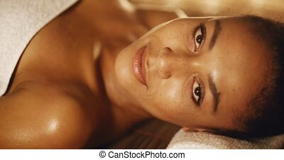 Woman Relaxing In A Wellness Center - Close up of a smiling...