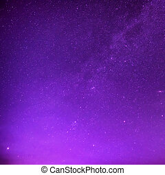 Beautiful purple night sky with many stars. Milkyway space...