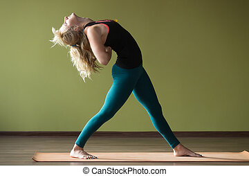Variation of Standing Backward Bend - Sporty beautiful blond...