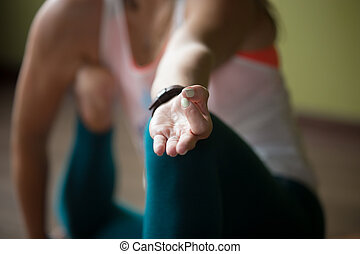 Close-up of Jnana mudra - Sporty beautiful young woman in...