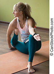Variation of Yogadandasana - Sporty beautiful blond young...