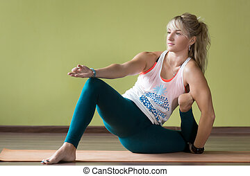 Hip-opening Yoga Pose - Sporty serene beautiful blond young...