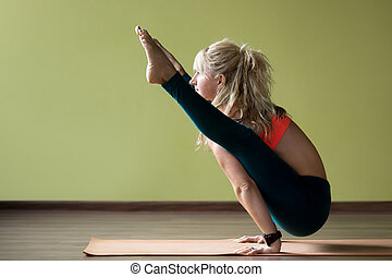 Firefly yoga pose - Sporty beautiful blond young woman in...