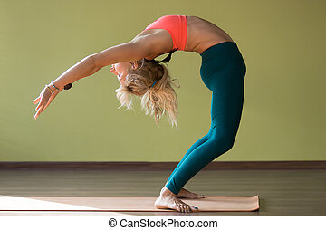 Half Wheel pose - Sporty attractive blond young woman in...