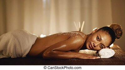 Woman Relaxing After Treatment - Young woman relaxing at spa...