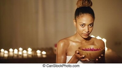Young Woman And Aromatherapy - Young woman holding bowl with...