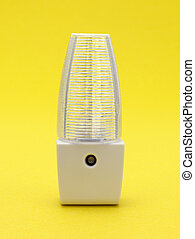 Generic LED night light on a yellow background - A new...