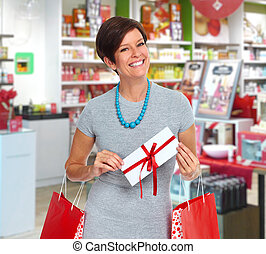 Smiling woman with greeting card. - Smiling woman with...