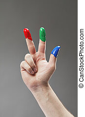 RGB - Fingers with fingerpaints in three primary colors,...