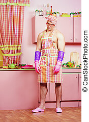 proof of love - Handsome muscular man in an apron cooking in...