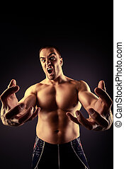 sports addiction - Muscular bodybuilder man stretching his...