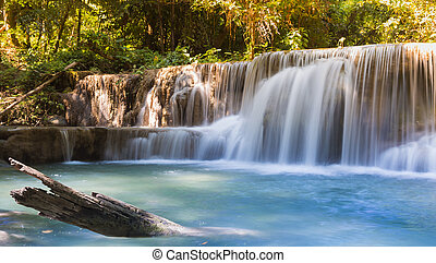 Beauty of blue stream waterfalls in deep forest north of...