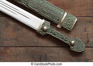 Old Dagger - Closeup of antique caucasian dagger and...