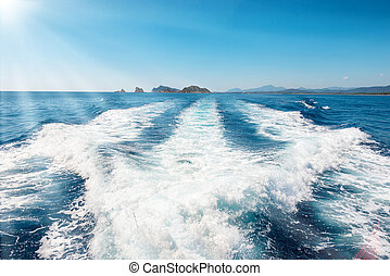 Waves on blue sea behind the boat - Waves on blue sea behind...