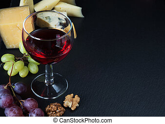 Red wine and snacks - Red wine, various types of cheese,...