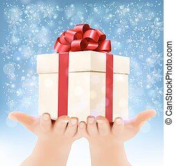 Holiday christmas background with hands holding gift box...