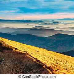 Blue mountains and hills over beautiful sunset
