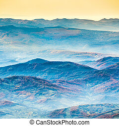 Beautiful blue mountains and hills at sunset time