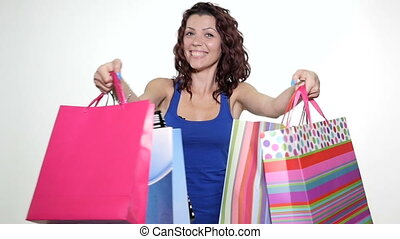 Woman being excited about shopping - Young attractive woman...
